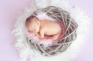 How many hours does the average newborn sleep per day?