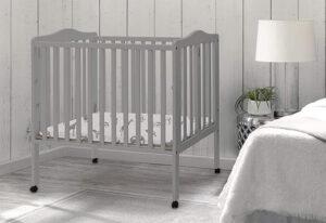 Delta Children Folding Portable Mini Baby Crib with 1.5-inch Mattress